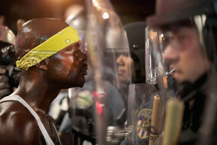 Image: Demonstrators confront police on Sept. 16.