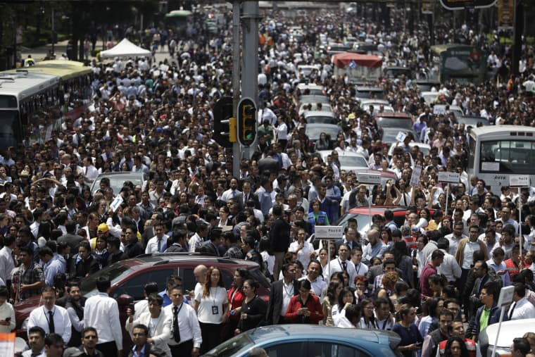 Image: People evacuated from office buildings gather in Reforma Avenue after an earthquake
