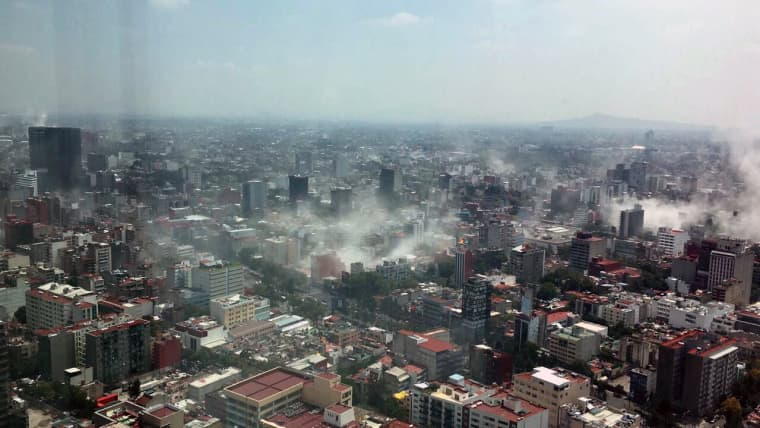 Image: Dust rises over downtown Mexico City during the earthquake