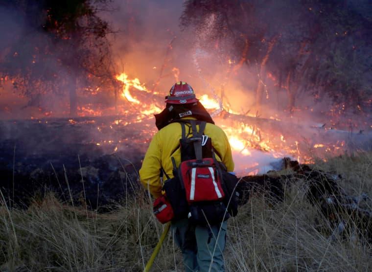 Image: Firefighters battle a wildfire near Santa Rosa, California, Oct. 14, 2017.