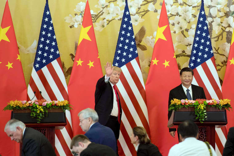 Image: President Donald Trump waves next to Chinese President Xi Jinping after delivering a joint statement