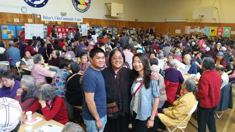 Rev. Norman Fong with youth volunteers at a Chinatown CDC Super Sunday gathering.