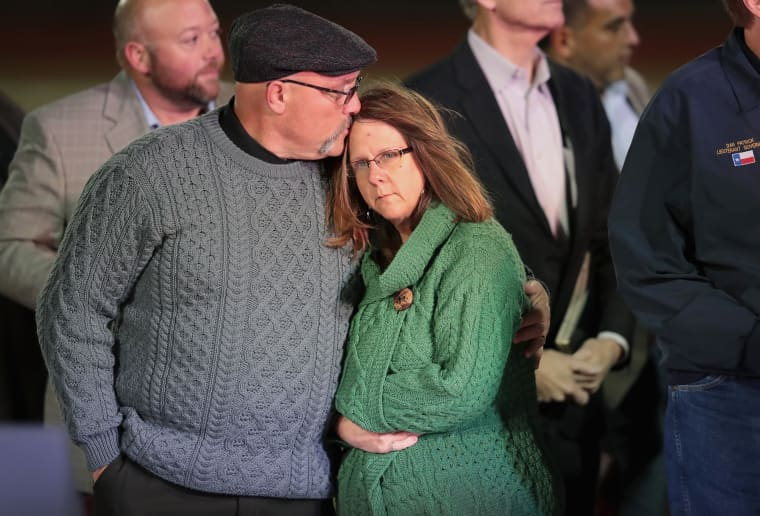 Image: Pastor Frank Pomeroy comforts his wife Sherri during a memorial service for the victims of the First Baptist Church of Southerland Springs shooting
