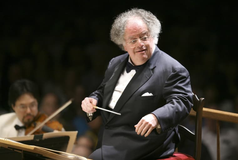 Image: James Levine, then-Boston Symphony Orchestra music director, conducts the symphony on its opening night performance at Tanglewood in Lenox., Massachusetts on July 7, 2006.