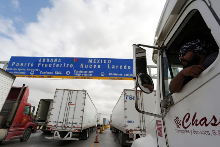 Image: Trucks waiting in line for border customs control to cross into U.S. at the World Trade Bridge in Nuevo Laredo, Mexico in this 2016 file photo.