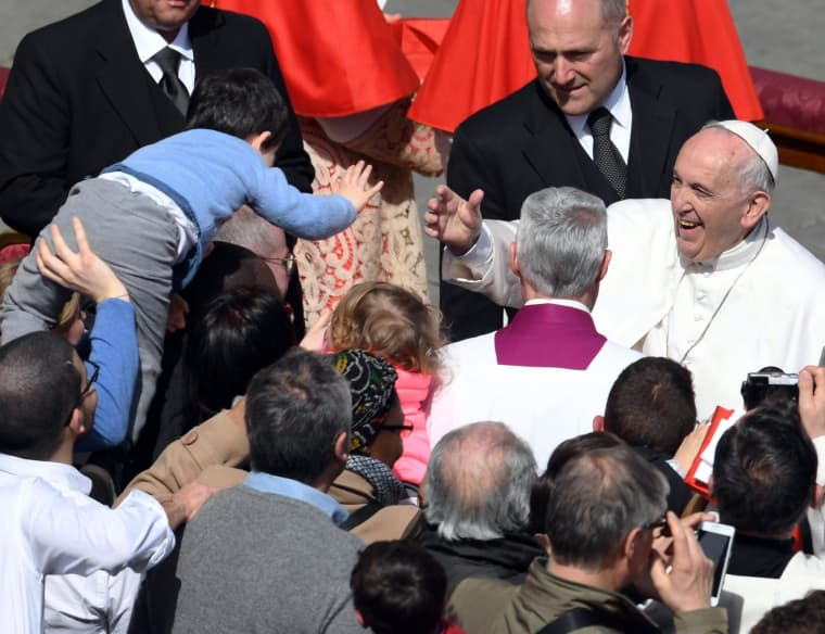 Image:Pope Francis meets a boy in the crowd after Easter Sunday mass at Vatican City.