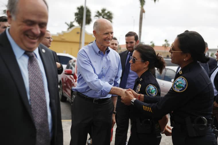 Image: Florida Governor Rick Scott is greeted as he arrives at Restaurant El Arepazo
