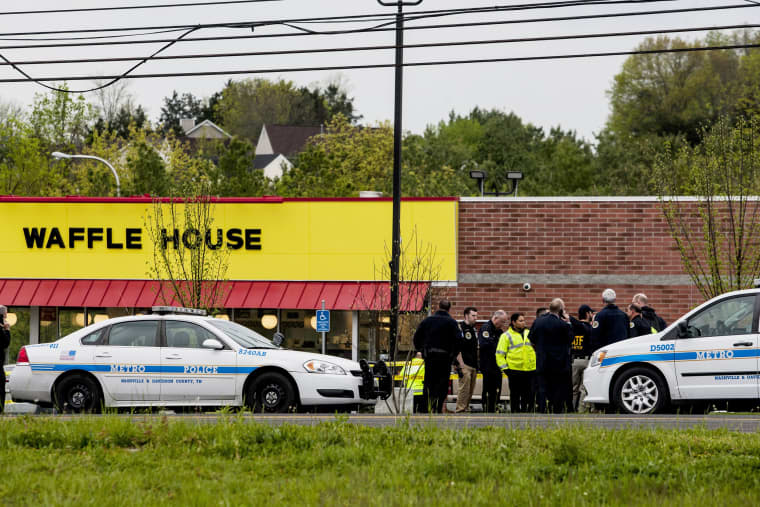 Image: Officials investigate the scene of a shooting at a Waffle House restaurant
