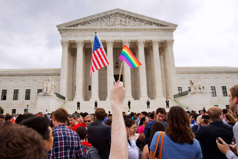 Image: A crowd gathers outside of the Supreme Court in Washington on June 26, 2015