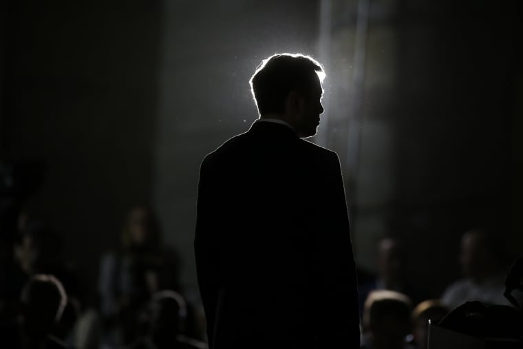 Image: Elon Musk listens during a news conference in Chicago