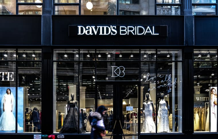 A pedestrian passes in front of a David's Bridal store in New York on Nov. 14, 2018.