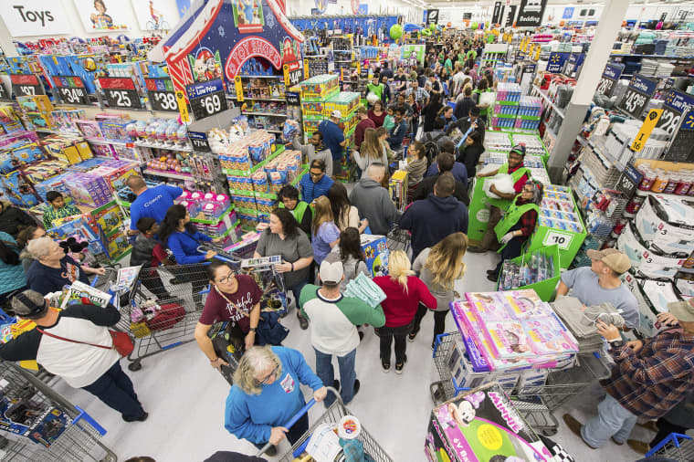 Image: Walmart customers shop deals on toys in America's Best Toy Shop during Walmart's Black Friday store event