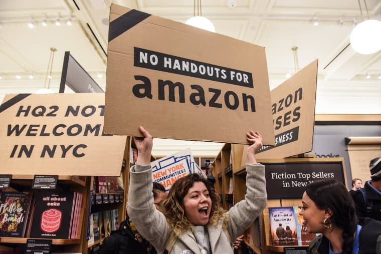 """Image: Protestors In New York City Hold \""""Day Of Action\"""" Against Amazon HQ2"""
