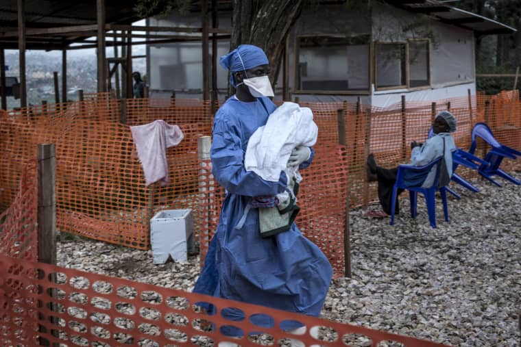 Image:A caretaker carries a baby suspected of having Ebola into a treatment center in Butembo, Congo, on Nov. 4, 2018.
