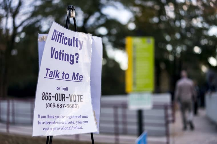 Image: At Pittman Park Recreation Center there were a limited amount of voting machines as thousands of voters waited to cast ballots in Atlanta on Nov. 6, 2018.