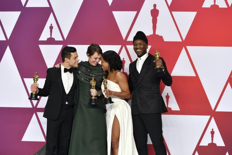 Image: Rami Malek, Olivia Colman, Regina King and Mahershala Ali celebrate their Academy Award wins at the Oscars on Feb. 24, 2019.