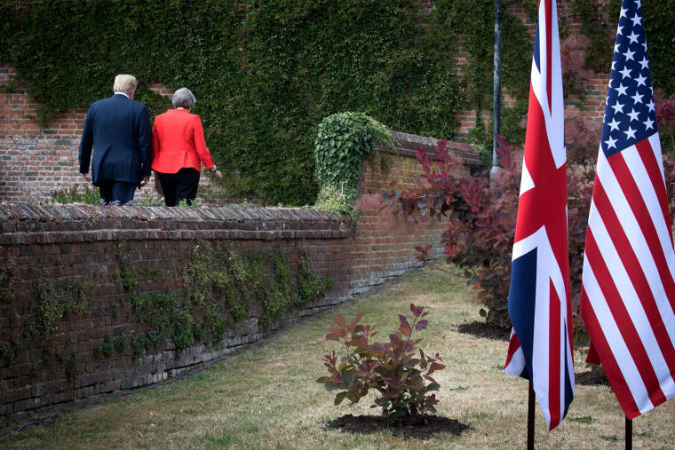 Image: President Donald Trump and British Prime Minister Theresa May walk following a press conference in London on July 13, 2018.