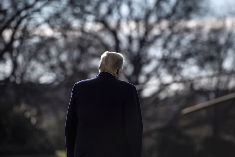 Image: President Donald Trump walks on the South Lawn of the White House on Dec. 7, 2018.