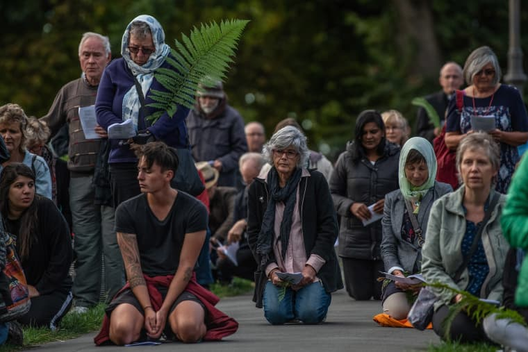 Image: People kneel for prayer during a vigil to remember victims of the Christchurch mosque attacks,