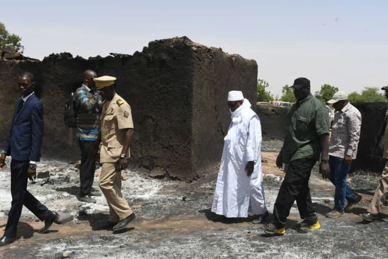 Image: Mali's President Ibrahim Boubacar Keita inspects the site of an attack by gunmen on Fulani herders in Ogossagou