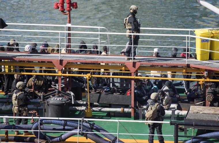Image: Armed forces stand onboard the Turkish oil tanker El Hiblu 1, which was hijacked by migrants, in Valletta, Malta