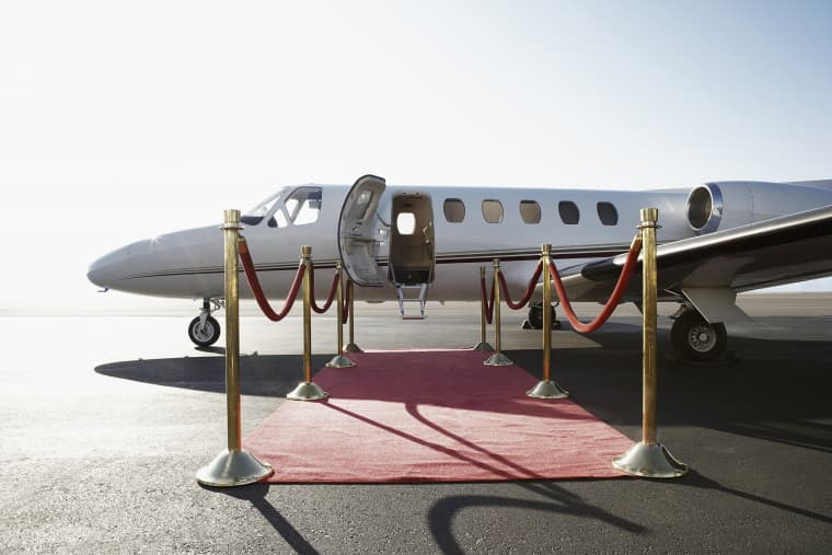 The superrich own jets and mega-yachts. The rich fly first class and buy sailboats.