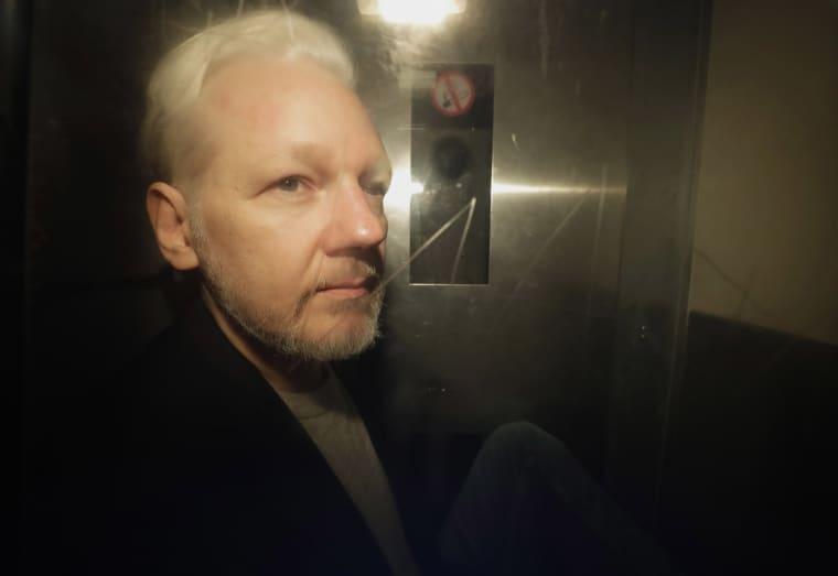 Image: WikiLeaks founder Julian Assange is taken from court in London