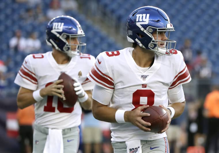 Image: New York Giants quarterbacks Eli Manning, left, and Daniel Jones warm up in Foxborough, Mass., on Aug. 29, 2019.