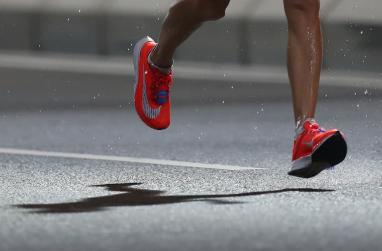 Image: A runner wears Nike Vaporfly  sneakers during the World Athletics Championships