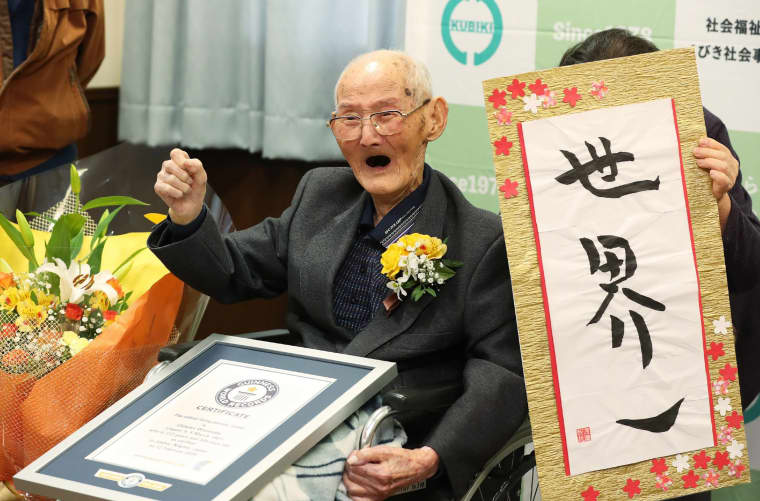 Image: 112-year-old Japanese man Chitetsu Watanabe poses next to calligraphy reading in Japanese 'World Number One' after he was awarded as the world's oldest living male in Joetsue