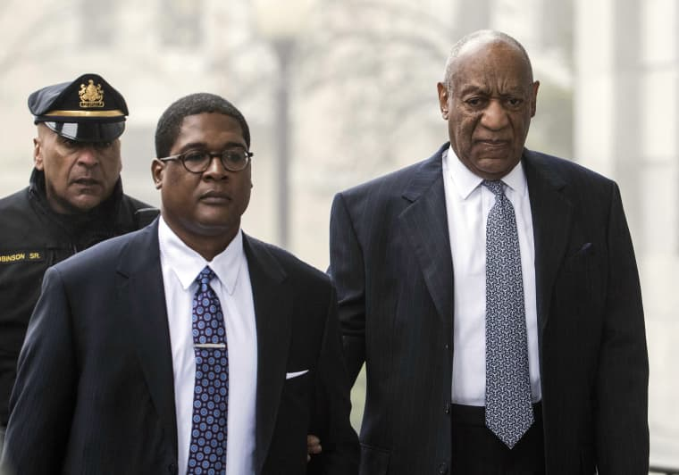 Image: Bill Cosby, right, arrives for his sexual assault case spokesperson Andrew Wyatt, center, at the Montgomery County Courthouse