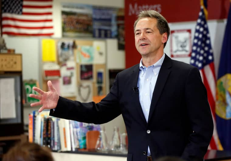 Image: Montana Governor Steve Bullock talks to the media and students at Helena High School as he launches 2020 U.S. presidential campaign in Helena, Montana