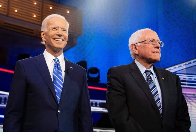 Image: Democratic presidential hopefuls Joe Biden and Bernie Sanders participate in the second Democratic primary debate at the Adrienne Arsht Center for the Performing Arts in Miami, Florida.