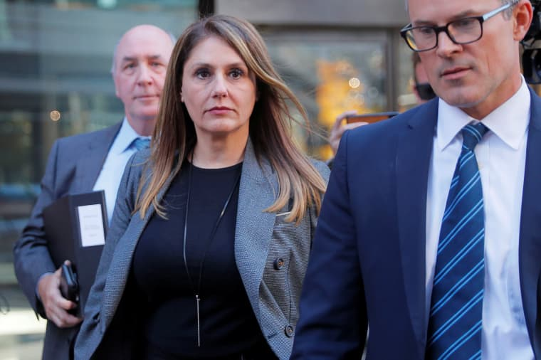 Image: Michelle Janavs leaves the federal courthouse in Boston