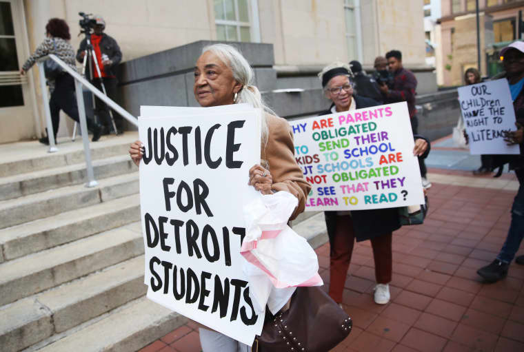 Helen Moore of Detroit leads a group of protesters at the Potter Stewart U.S. Federal Courthouse in Cincinnati