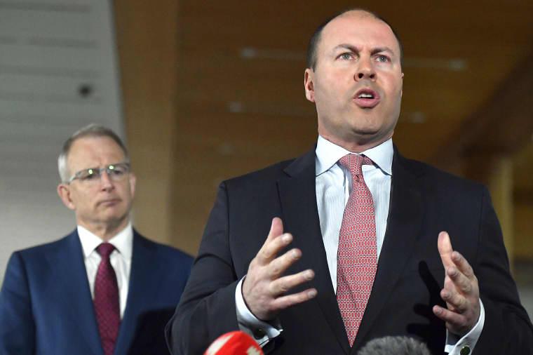 Australia's Treasurer Josh Frydenberg, right, with Minister for Communications Paul Fletcher speaks in Canberra on April 20, 2020.