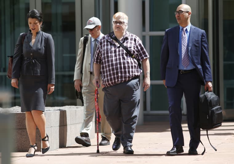 Dana Zzyym, third from left, walks out of court in Denver in 2016.