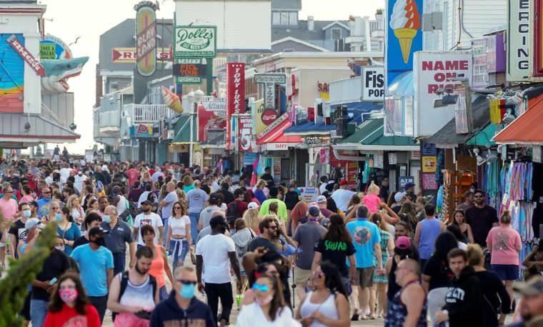 Image: Visitors crowd the boardwalk on Memorial Day weekend in Ocean City, Maryland