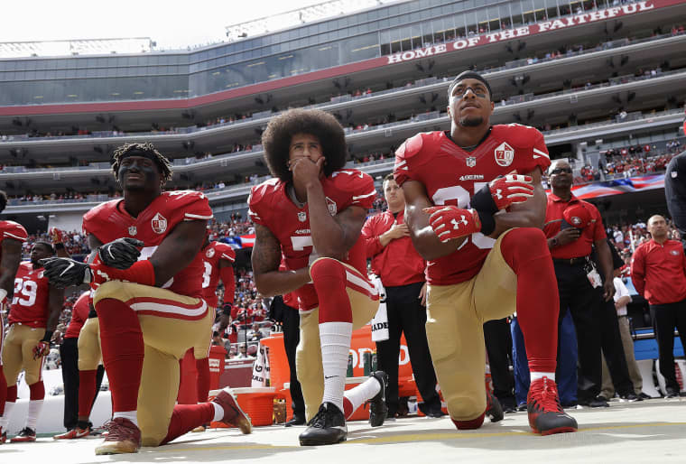 Image: San Francisco 49ers outside linebacker Eli Harold, left, quarterback Colin Kaepernick, center, and safety Eric Reid kneel during the national anthem before an NFL football game against the Dallas Cowboys in Santa Clara, Calif