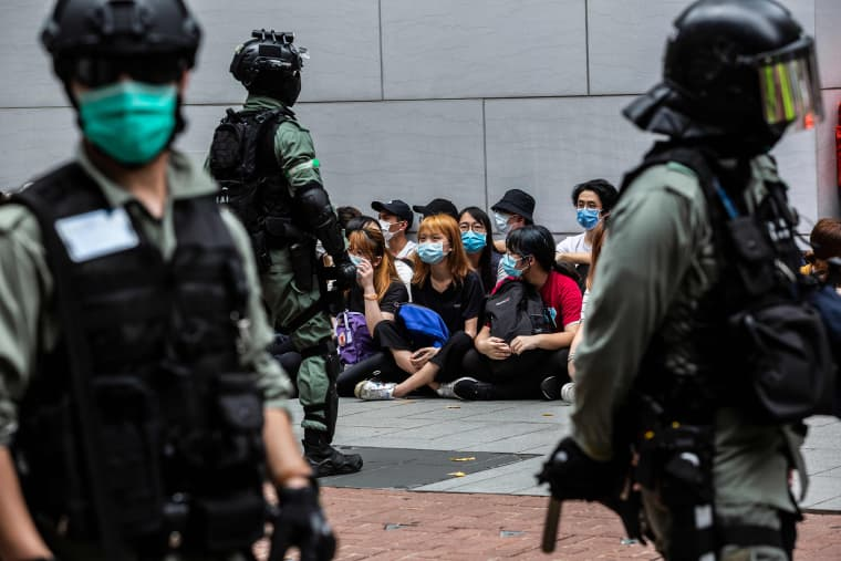 Image: Riot police detain a group of people during a protest in the Causeway Bay district of Hong Kong