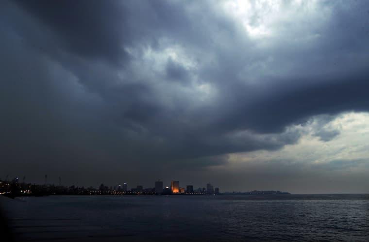 Image: Dark clouds hang over the city ahead of cyclone Nisarga making landfall in Mumbai, India