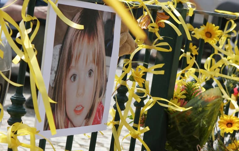 Image: Yellow ribbons, candles and a picture of Madeleine McCann are seen on the railings outside the reception of the Ocean Club in Praia da Luz, Portugal