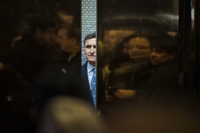 Image: Retired Lt. Gen. Michael Flynn boards an elevator at Trump Tower