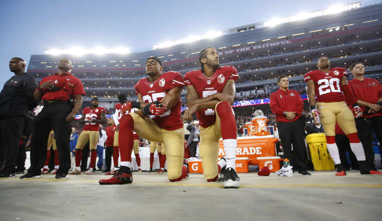 Image: Eric Reid and Colin Kaepernick of the San Francisco 49ers kneel during the national anthem in Santa Clara, Calif., in 2016.
