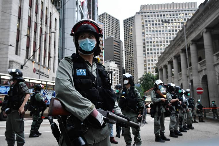 Image: Riot police stand guard ahead of a pro-democracy march in Hong Kong
