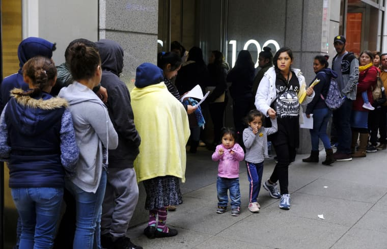 Hundreds of people stand in line outside an immigration office in San Francisco on Jan. 31, 2019.