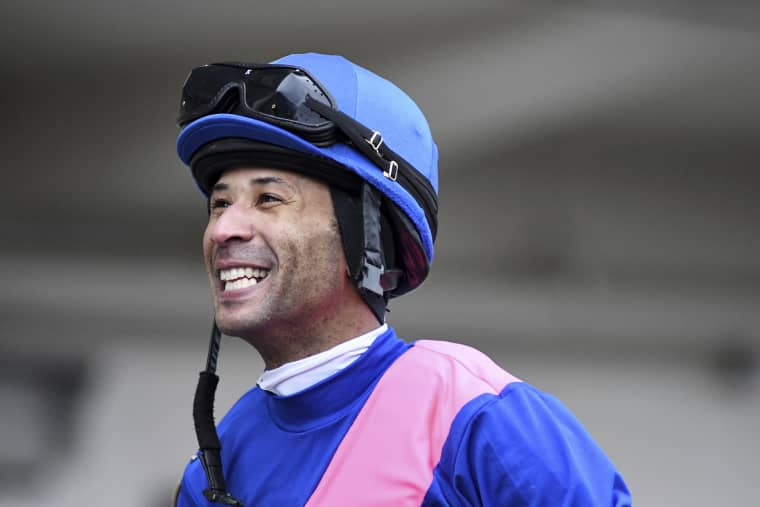 Kendrick Carmouche smiles in the paddock at Aqueduct Racetrack in the Queens borough of New York on Jan. 24, 2020.