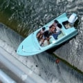 Video shows boat with 4 women hanging over dam