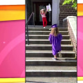 Little boy holds ceremony for his big sister's graduation (from pre-K)