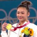 Suni Lee celebrates gold medal win, Simone Biles' Olympic status remains uncertain